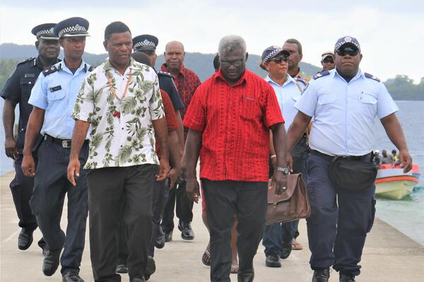 Prime Minister is escorted by GP Deputy Premier on arrival at Marau sound.