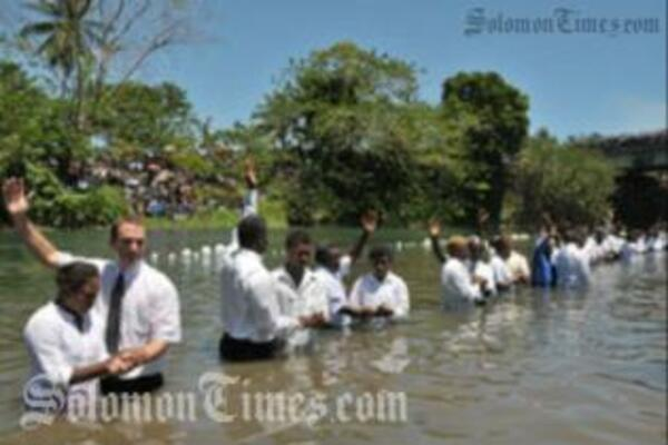 Adventist pastors baptizing new church members in the Lunga River last week.