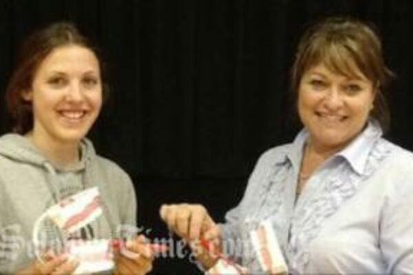 CCC student Rebecca Hawksworth (L) and Liz Turnbull, of Channon and Lawrence Dental Care who provided teaching and training materials.