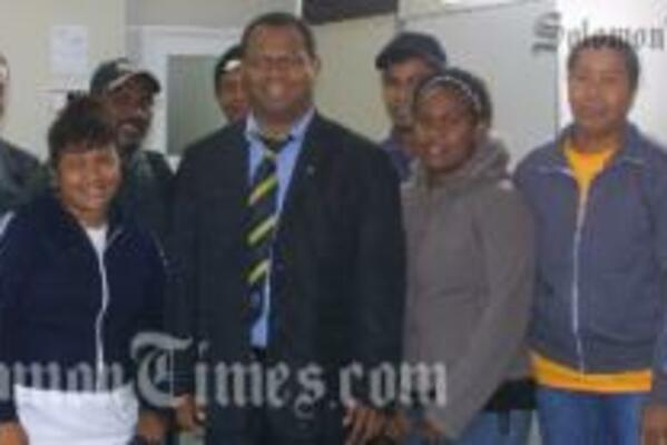 Steve Abana (third left) with officials and fellow Solomon Islanders at Aongatete.