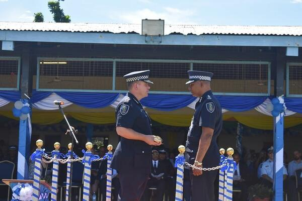 Outgoing Police Commissioner Varley handed the 'sword' over to Acting Commissioner of Police, Mostyn Mangau.