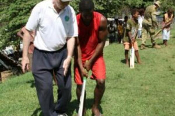 S.I Cricket Association member, Mr. Graeme Wilson during a cricket lesson.
