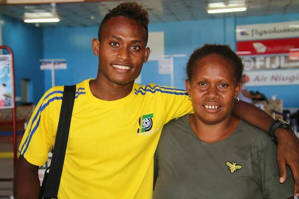 Youngster, Raphael Ohanua Leai with his proud mother at the Honiara International Airport.