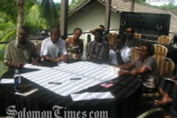 The Solomon Island delegation in discussion during the workshop.