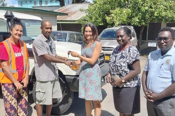 Australian High Commission First Secretary (Health) Fiona Mulhearn hands over a Land Cruiser to the Guadalcanal Provincial Health Director Dr Joel Denty. At the handing over was the Permanent Secretary for the Ministry of Health Pauline McNeil and her staff.