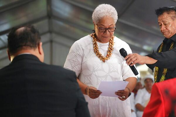Samoa's first female prime minister was locked out of parliament by the country's outgoing leader - but still sworn into office in a makeshift ceremony held inside a tent.