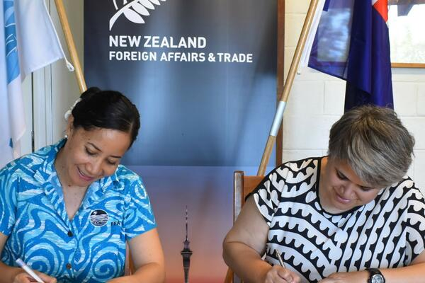 FFA Director General, Dr Manu Tupou-Roosen and  NZ High Commissioner Georgina Roberts sign $18million agreement for support to Pacific Fisheries.