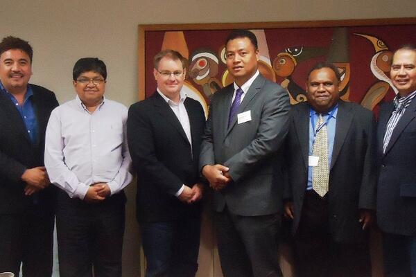 Hon. Clay Forau and the staff of Pacific Islands Trade and Investment in Auckland recently.