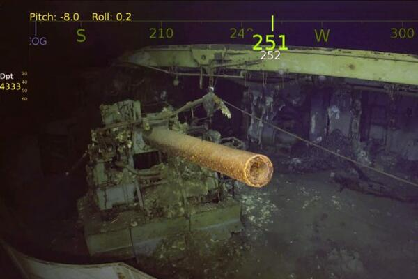 One of the USS Wasp's five-inch guns looms out of the murk of the Coral Sea.