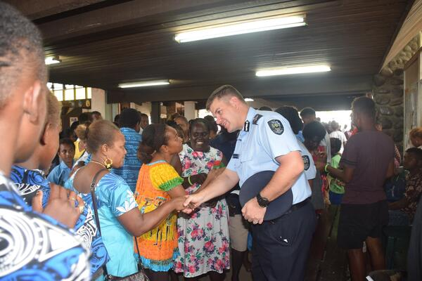 Commissioner Varley shakes hands with some women after the awareness program.