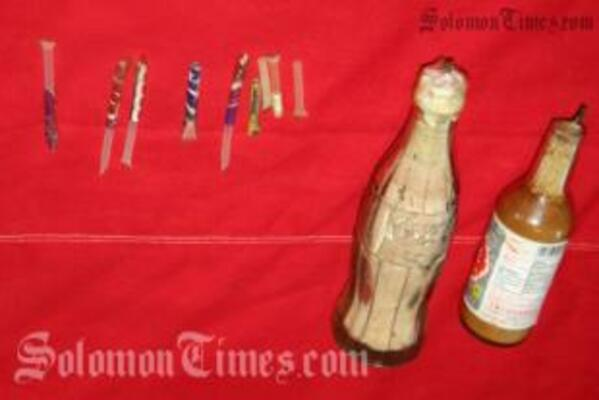 Two improvised explosives made from bottles, explosive powder and  wick fuses seized by police.