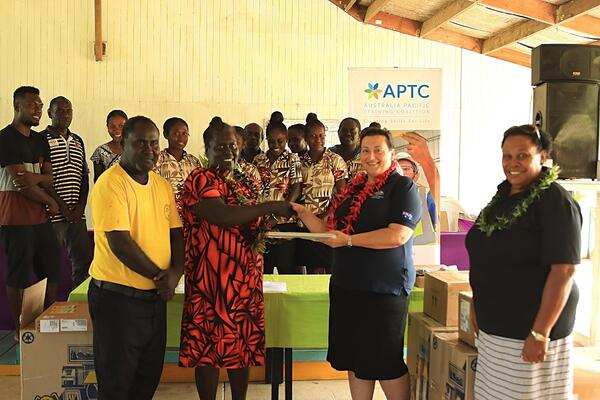 Second Secretary at the Australian High Commission in Solomon Islands, Christina Skoumbourdis, hands over laptops to Tabak reps.