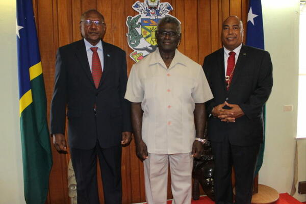 Prime Minister Sogavare, centre and Minister for Foreign Affairs and External Trade, Hon Milner Tozaka, left end, with the new Solomon Islands High Commissioner to Australia, His Excellency Colin David Beck.