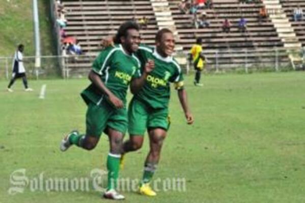 Benjamin Totori and Henry Fa'arodo Jnr celebrate Totori's goal.