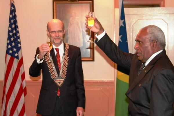 Sir Frank Kabui, the Solomon Islands Governor General proposes a toast to the people of United States while Ambassador North looks on.