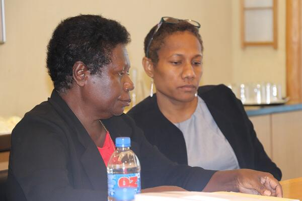 Commissioners, Ms. Ruth Liloqula (L), and Ms. Anika Kingmele (Vice Inaugural Chairperson) during the Commissioner's induction program that was facilitated and supported by UNDP.