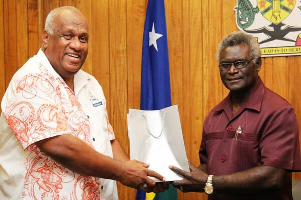 PIDF Deputy Director General, Mr Lomaloma presents a gift to the PIDF Chair, Prime Minister Sogavare at their meeting.