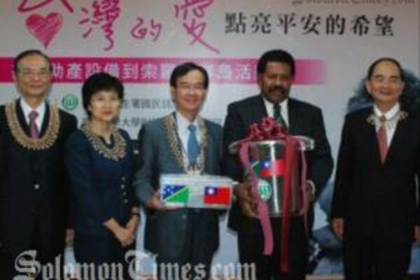 Solomon Islands Ambassador to Taiwan, Victor Ngele, while receiving the items.