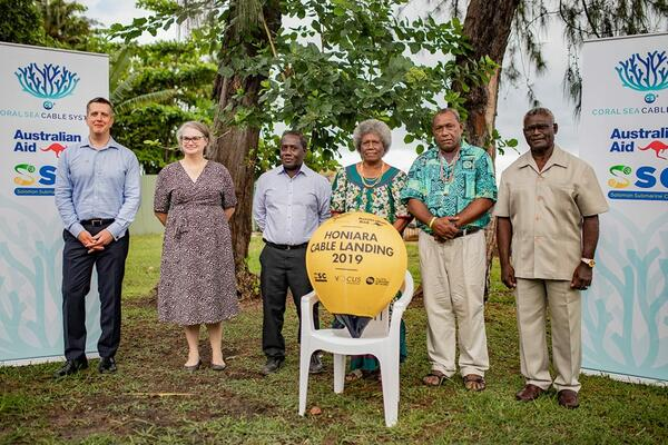 Representatives from Vocus, the Australian High Commission, Honiara, SISCC and traditional landowners association with the Solomon Islands Prime Minister Sogavare during the symbolic handover of the golden bouy.