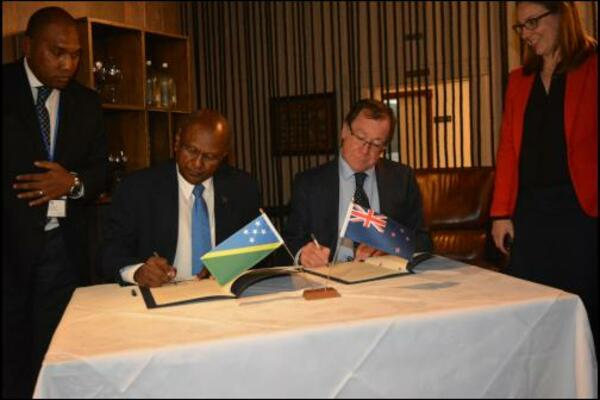 Hon. Milner Tozaka, MP, Minister of Foreign and External Trade and his counter-part, Hon. Murray McCully MP, Minister of Foreign Affairs of New Zealand sign the revised Joint Commitment for Development.