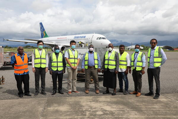 SIG and Chineses Officials witness the arrival of the testing machines at Honiara International Airport.