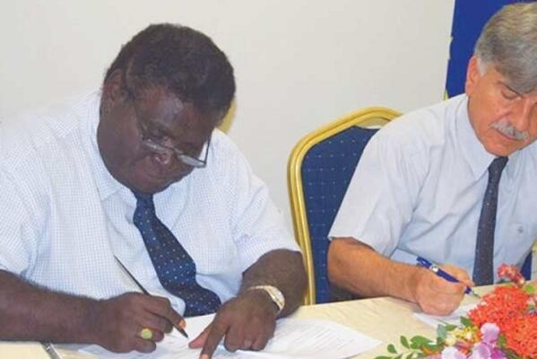 Minister for Development Planning and Aid Coordination, Hon Philip, left, and the EU Ambassador to Solomon Islands HE Tezapsidis sign the SBD$90-Million financing agreement.