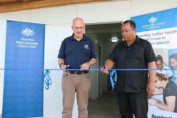 Australian High Commissioner Dr Lachlan Strahan and Minister for Health and Medical Services, Hon. Dickson Mua at the handover ceremony.