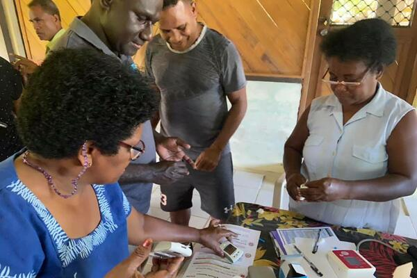Blood sugar test and blood pressure readings being conducted at the Kilu'ufi Hospital in Auki.