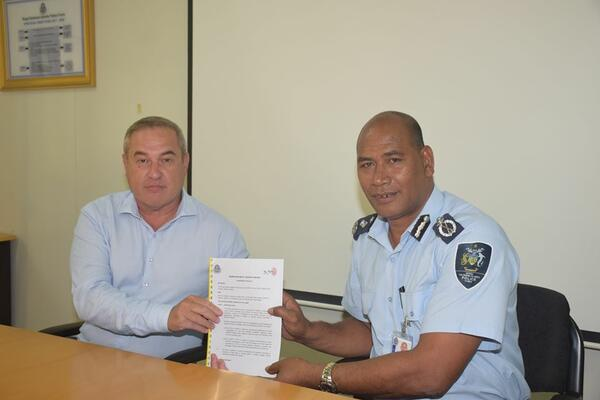 Acting Commissioner Mostyn Mangau and the Solomon Telekom Chief Executive Officer (CEO) Arthur Yen, with the signed Memorandum of understanding (MoU).