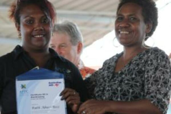 Ruth Bosi(L)receives her certificate from Ms. Afu Billy, Regional Director to the Commonwealth Youth Programme.