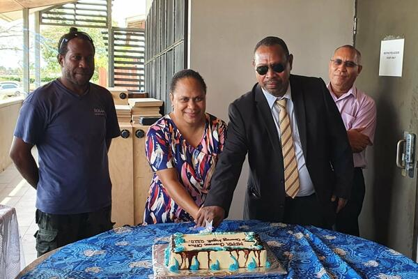 Cutting of the cake by Minister of Fisheries, Hon. Nestor Giro and PROP Coordinator, Samantha Tuti. Looking on SSWA Contractor, Simon Aita'a (left) and PS Fisheries, Dr Christain Ramofafia.
