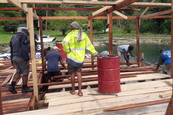 PRT officers and members of the local community construct the Kulitanai jetty.