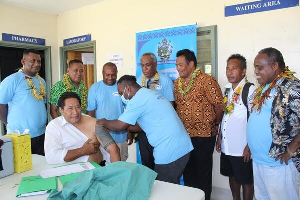 Premier Hon. Willy Tuhagenga taking the first COVID-19 jab for Renbel province.