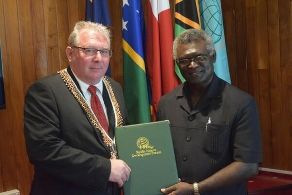 PIDF Secretary-General Francois Martel, (left), with Solomon Islands Prime Minister, Hon. Manasseh Sogavare.