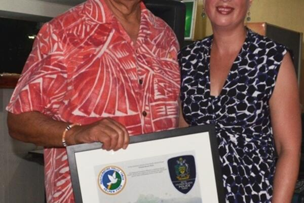 Secretary General of the Pacific Islands Forum, Tuiloma Neroni Slade receives a farewell gift from RAMSI Special Coordinator, Ms Justine Braithwaite during a RAMSI hosted function in Honiara.