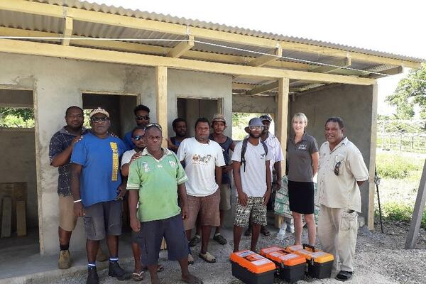 Plumbing training participants and APTC staff - plumbing trainer, James Matariki, and Vocational Training Manager for Vanuatu and Nauru, Natasha Murray.