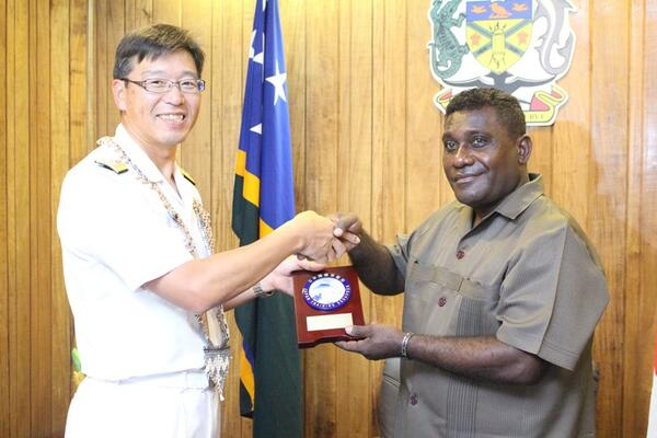Rear Admiral Yuasa presents a gift to PM Lilo.