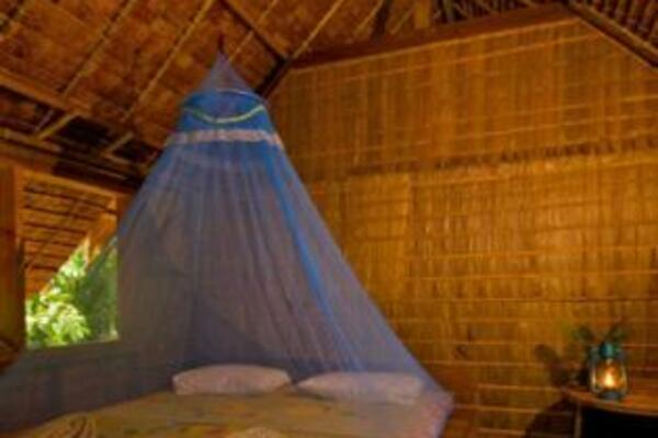 A room in a traditional leaf house at the TDA-run Tetepare Island Ecolodge.