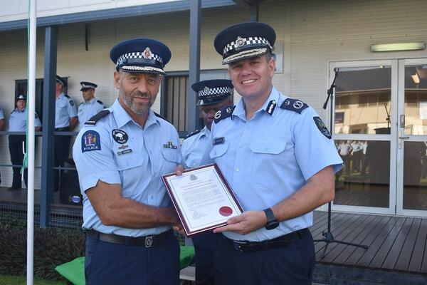 RSIPF Commissioner Varley presents outgoing SIPSP Team Leader Razos with a letter of commendation.