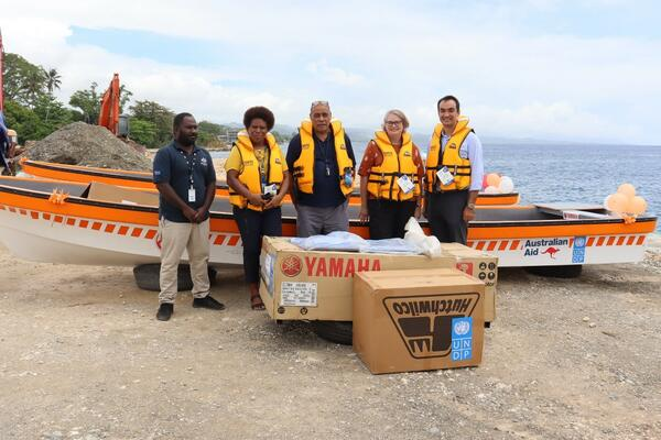 Australian High Commission, UNDP and N-DOC members posed with the boats and equipment.