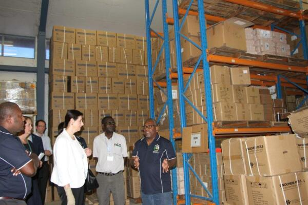 Australian Minister for International Development and the Pacific, the Hon Concetta Fierravanti-Wells, being briefed by Mr Willie Horoto, at the National Medical Store.