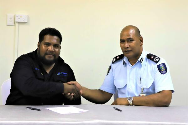 Police Commissioner, Mr. Mostyn Mangau and SICCI Board Chairman, Mr. Ricky Fuo'o at the signing of the MoU.