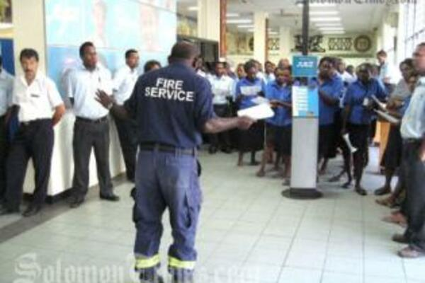 RSIPF Fire Service's Inspector Rodney Kuma entertained and educated bank staff during his fire safety lecture.