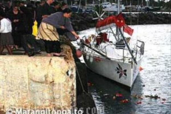 Flowers are thrown over the last mooring place of the MV Princess Ashika.
