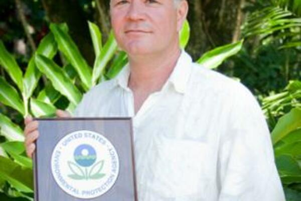 Mr. Espen Ronneberg with SPREP's ozone award.