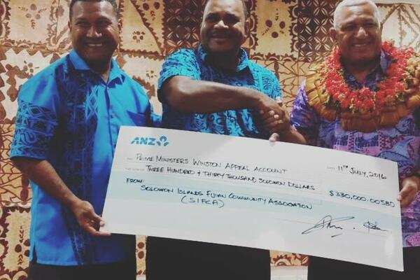 Fiji's Prime Minister, Hon. Voreqe Bainimarama (far right) and members of the Solomon Islands Fijian Community, Mr. Matai Vave (L) and Mr. Tamana Kativerata (C).