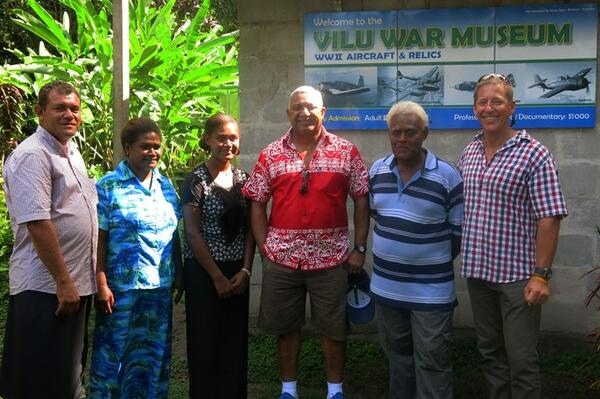 The Fijian Prime Minister stands with Glenn Bennett, Managing Director, Silentworld Shipping (far right), Reginald Douglas, director of Dalgro (far left) as well as museum owners Anderson Dua and his family.