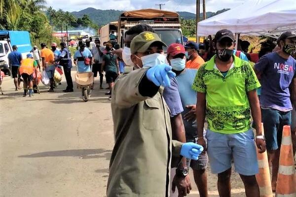 Fiji military directing people at a COVID-19 testing centre in the Lami-Suva-Nausori containment area.