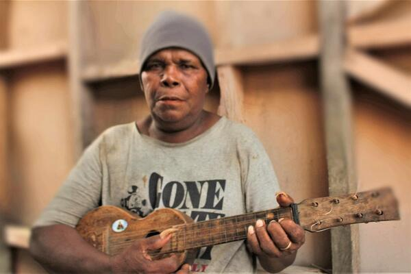 Jackson Akwasia with his homemade ukulele.