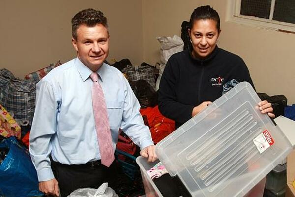 Kingsford-Smith federal Labor MP Matt Thistlethwaite with Jean Ford with all of the clothes and items collected to be sent to the Solomon Islands.